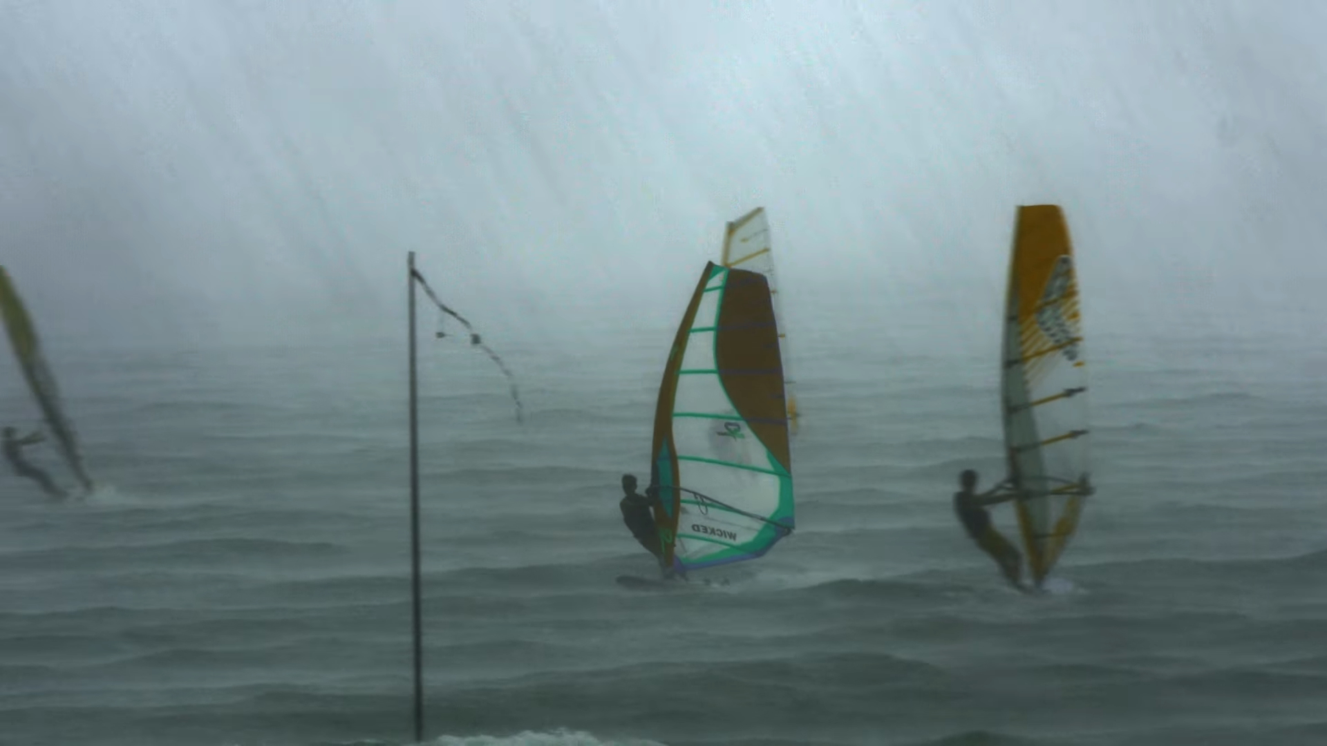 Windsurfing under a storm in East Coast Park, Singapore