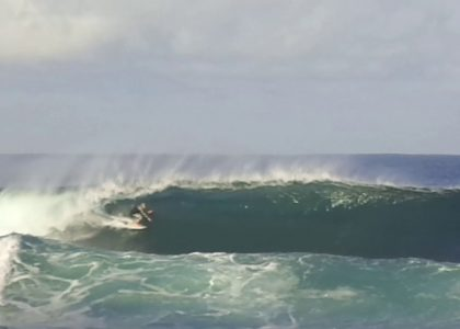 An old man surfing in Margaret River On a Sunday Morning